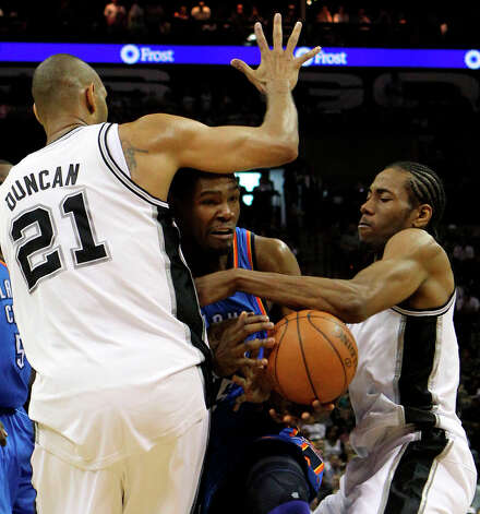 Thunder's Kevin Durant (35) is trapped between Spurs' Tim Duncan (21) and San Antonio Spurs' Kawhi Leonard (2) during the first half of game two of the NBA Western Conference Finals in San Antonio, Texas on Tuesday, May 29, 2012. Photo: Kin Man Hui, San Antonio Express-News / © 2012 San Antonio Express-News