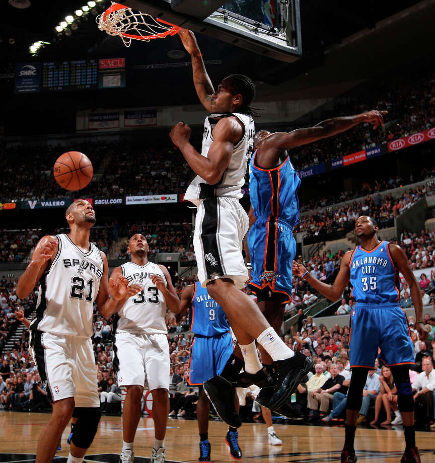 Spurs' Kawhi Leonard (2) dunks over Oklahoma City Thunder's Kendrick Perkins (5) during the first half of game two of the NBA Western Conference Finals in San Antonio, Texas on Tuesday, May 29, 2012. Photo: Edward A. Ornelas, San Antonio Express-News / © 2012 San Antonio Express-News