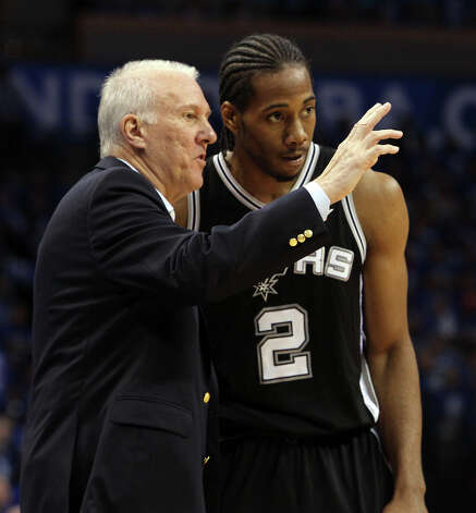 Spurs coach Gregg Popovich talks to Kawhi Leonard (2) during the first half of Game 3 of the NBA Western Conference Finals in Oklahoma City, Okla. on Thursday, May 31, 2012. Photo: Kin Man Hui, San Antonio Express-News / © 2012 San Antonio Express-News