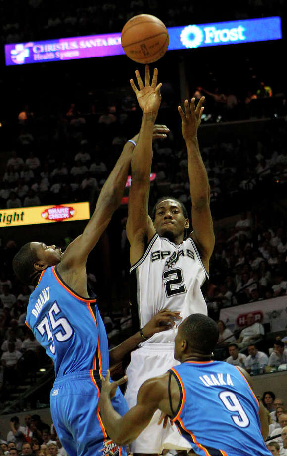 Spurs' Kawhi Leonard (2) shoots against Thunder's Kevin Durant (35) and Serge Ibaka (9) during the first half of Game 5 of the NBA Western Conference Finals in San Antonio, Texas on Monday, June 4, 2012. Photo: Kin Man Hui, San Antonio Express-News / © 2012 San Antonio Express-News