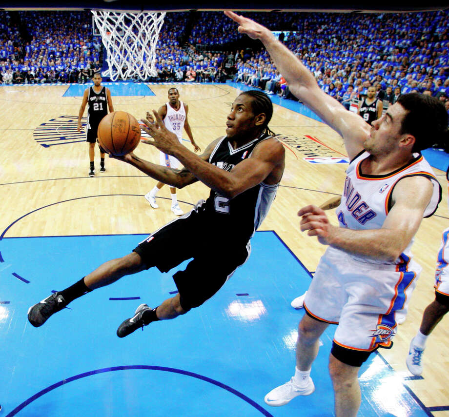 Spurs small forward Kawhi Leonard (2) shoots against Thunder power forward Nick Collison (4) during the first half of Game 3 in their NBA basketball Western Conference finals playoff series, Thursday, May 31, 2012, in Oklahoma City. Photo: Sue Ogrocki, Associated Press / AP