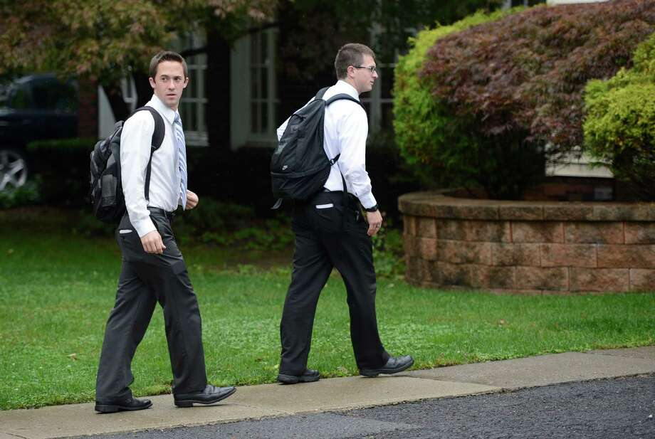 Mormon missionaries, Elder Caden Portela of Firth, Idaho, right and Elder Kenny Seymour of Anaheim, California walk Harris Street during their missionary work in Albany, N.Y. Oct. 4, 2012.     (Skip Dickstein/Times Union) Photo: Skip Dickstein / 00019526A