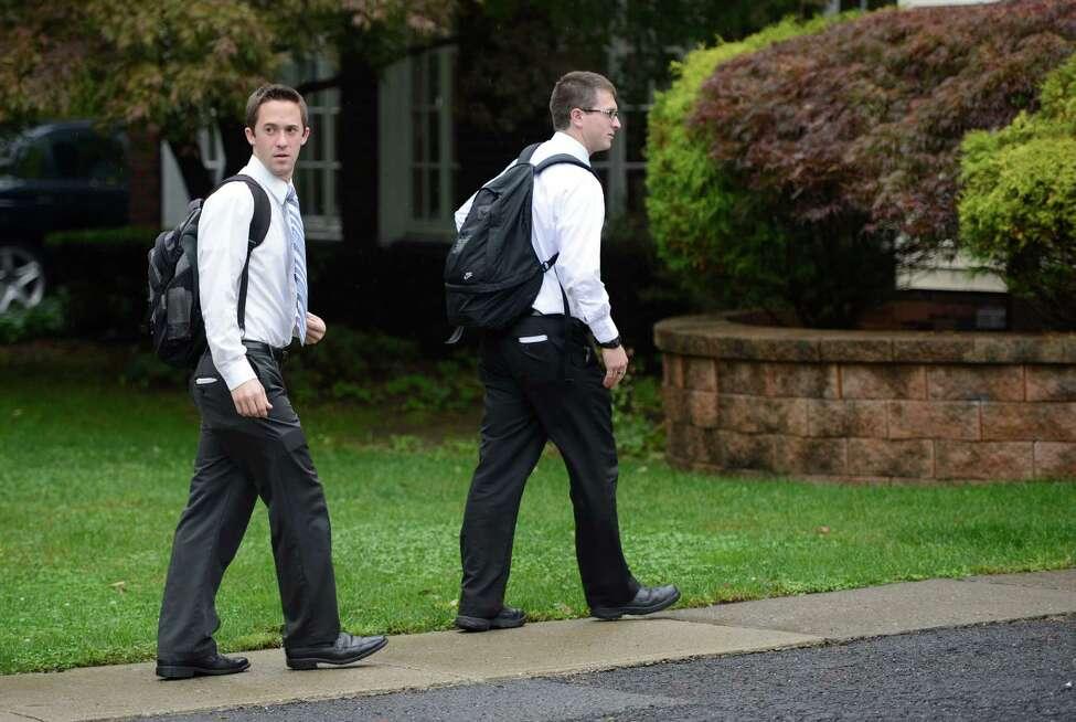 Mormon missionaries, Elder Caden Portela of Firth, Idaho, right and Elder Kenny Seymour of Anaheim, California walk Harris Street during their missionary work in Albany, N.Y. Oct. 4, 2012. (Skip Dickstein/Times Union)