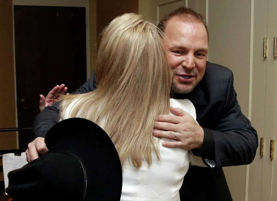 Garth Brooks, right, hugs Mary Chapin Carpenter before the Nashville Songwriters Hall of Fame inductions on Sunday, Oct. 7, 2012, in Nashville, Tenn. Carpenter is one of the inductees. (AP Photo/Mark Humphrey) Photo: Mark Humphrey / AP