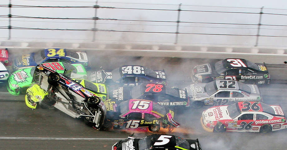 It didn't take place until the final lap, but the customary massive wreck at Talladega involved 25 cars, including Tony Stewart's flying No. 14. Photo: Dale Davis / FR386386 AP