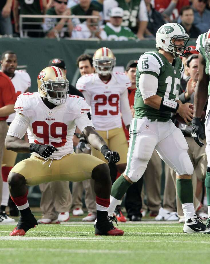 EAST RUTHERFORD, NJ - SEPTEMBER 30: Aldon Smith #99 of the San Francisco 49ers celebrates after he tackled Tim Tebow #15 of the New York Jets on September 30, 2012 at MetLife Stadium in East Rutherford, New Jersey.The San Francisco 49ers defeated the New York Jets 34-0.  (Photo by Elsa/Getty Images) Photo: Elsa / 2012 Getty Images