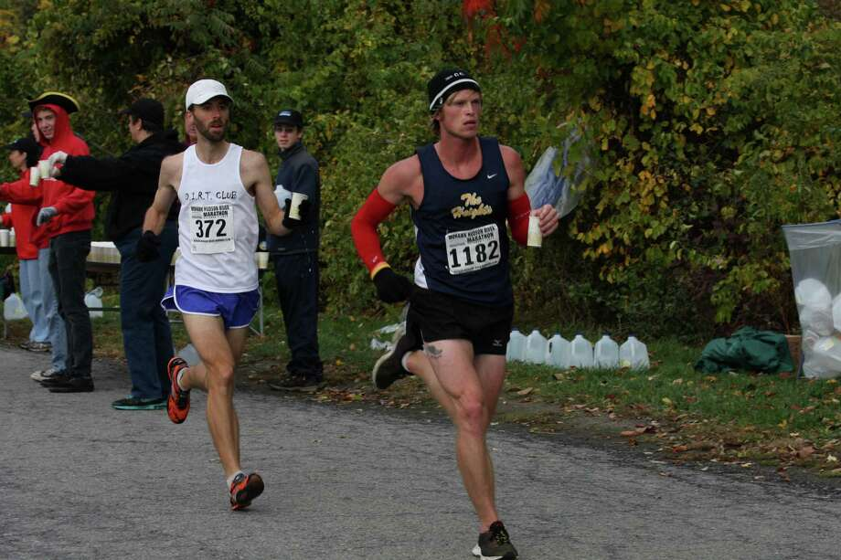 Eventual race winner Kyle Smith of Linden, Mich., runs just ahead of Jeremy Drowne of West Chazy during the Mohawk-Hudson River Marathon on Sunday, Oct. 7, 2012. (Courtesy of Bill Meehan) Photo: William Meehan