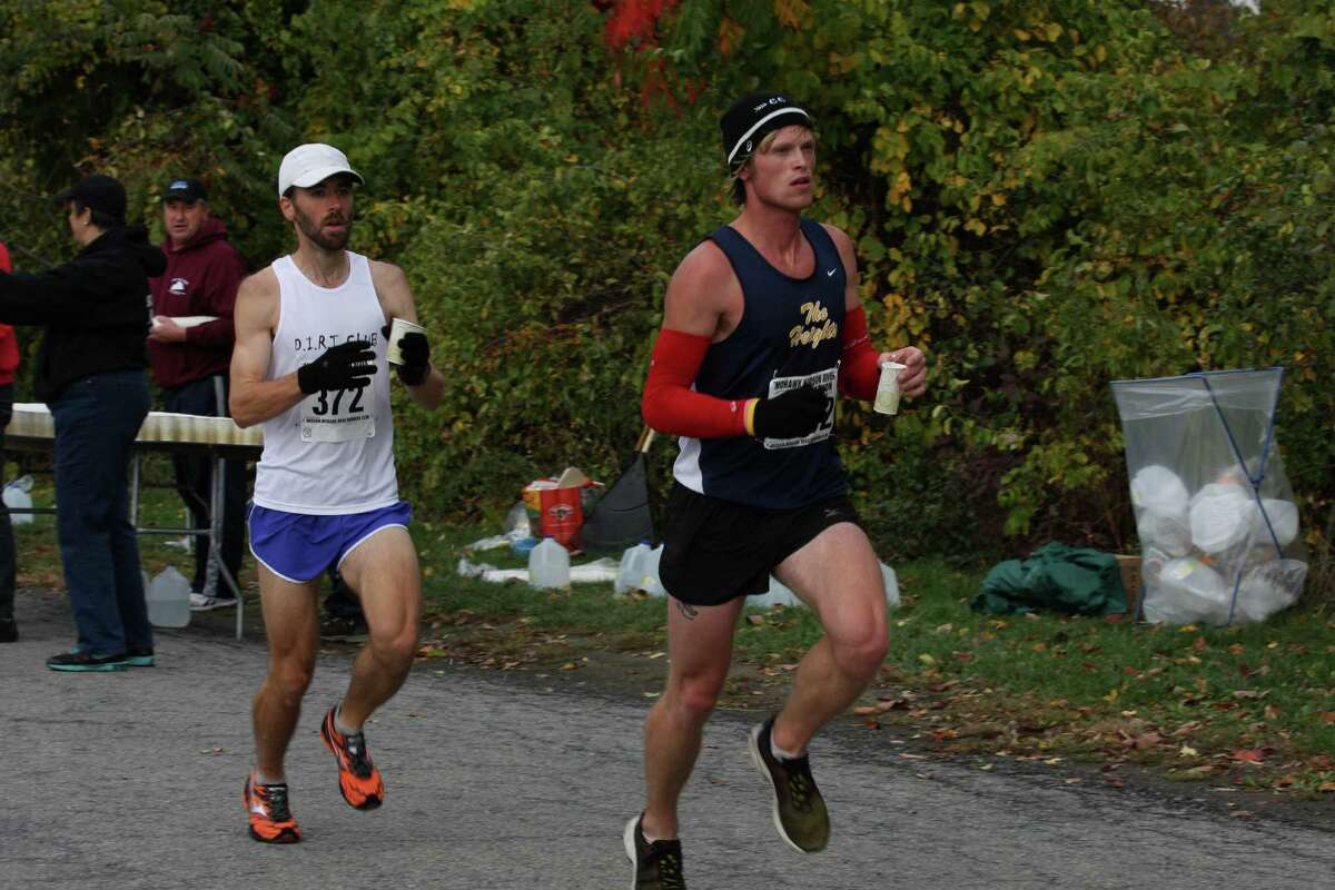 Eventual race winner Kyle Smith of Linden, Mich., runs just ahead of Jeremy Drowne of West Chazy during the Mohawk-Hudson River Marathon on Sunday, Oct. 7, 2012. (Courtesy of Bill Meehan)
