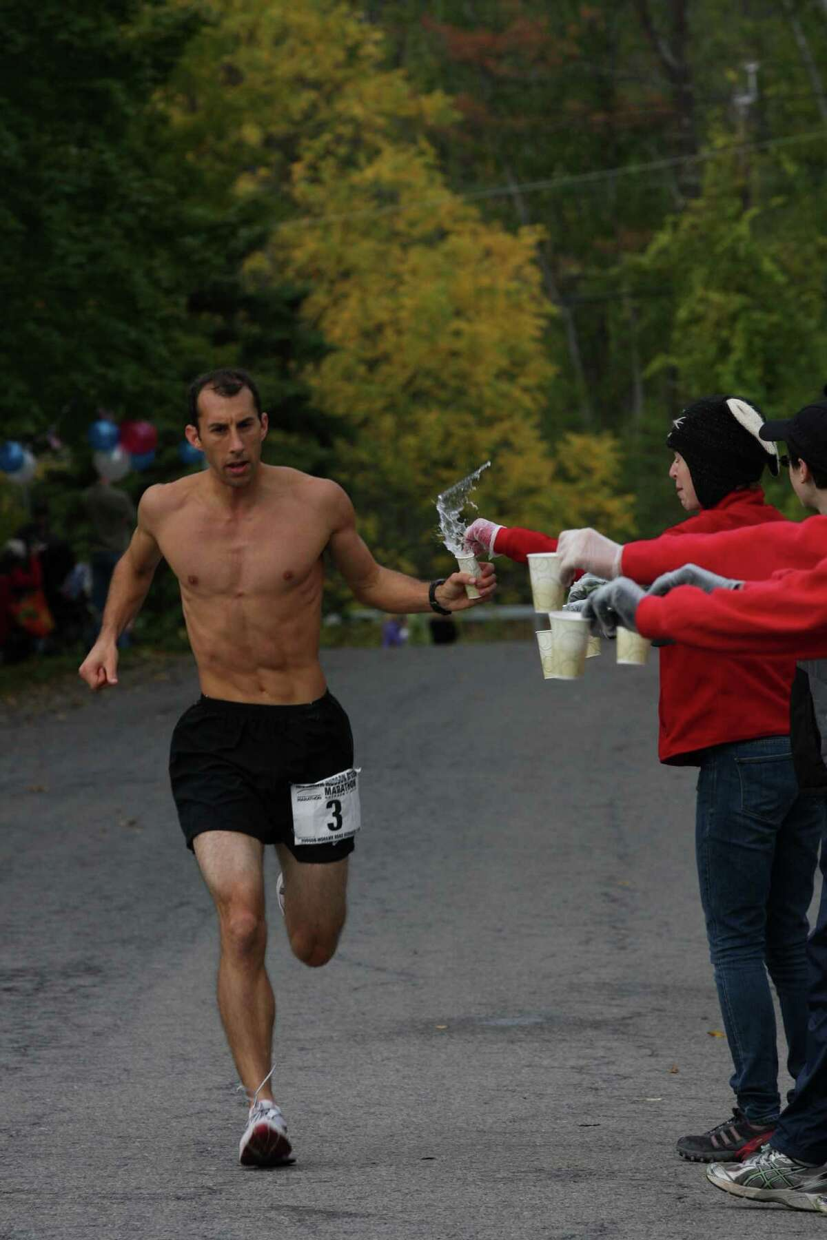 Third-place finisher Sean Gallagher of Clearwater, Fla., grabs some water during the Mohawk-Hudson River Marathon on Sunday, Oct. 7, 2012. (Courtesy of Bill Meehan)
