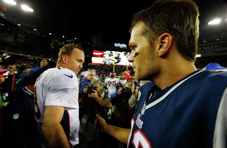 FOXBORO, MA - OCTOBER 07:  Tom Brady #12 of the New England Patriots and Peyton Manning #18 of the Denver Broncos greet each other at midfield following the game on October 7, 2012 at Gillette Stadium in Foxboro, Massachusetts. Photo: Jared Wickerham, Getty Images / 2012 Getty Images