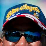Mike Hanaike, a self hardcore Blue Angel Fan, watches the skies during the Fleet Week Air Show Sunday, October 7, 2012.