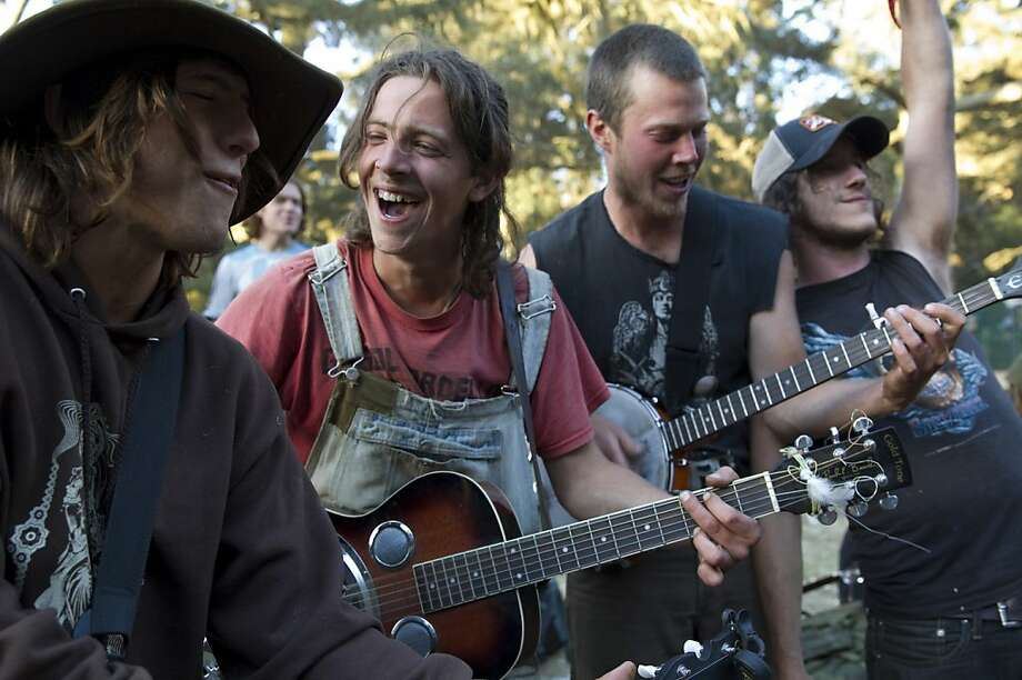 Clint Ross, Ryan Fournier, Scott Smith and Jake Dore (left to right) play with their band The Itty Bitty String Band on the last day of Hardly Strictly Bluegrass in Golden Gate Park in San Francisco, Calf., on Sunday, October 7, 2012.  The band had been busking in the park throughout the festival. Photo: Laura Morton, Special To The Chronicle