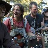 Clint Ross, Ryan Fournier, Scott Smith and Jake Dore (left to right) play with their band The Itty Bitty String Band on the last day of Hardly Strictly Bluegrass in Golden Gate Park in San Francisco, Calf., on Sunday, October 7, 2012.  The band had been busking in the park throughout the festival.