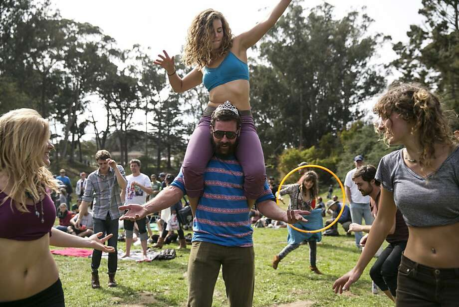Amy Winzer dances on the shoulders of Brad Graevs with Lauren Saint (left) and Jes Hagan (right) while listening to the performance of the band Soul Rebels at the Towers of Gold Stage during the last day of Hardly Strictly Bluegrass in Golden Gate Park in San Francisco, Calf., on Sunday, October 7, 2012. Photo: Laura Morton, Special To The Chronicle