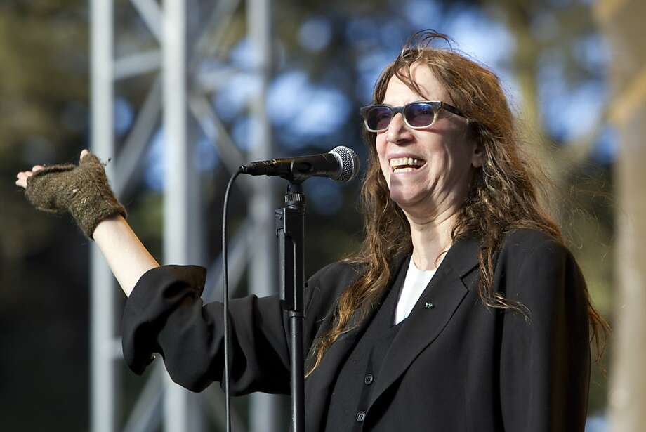 Patti Smith waves to the crowd that gathered at the Towers of Gold Stage to watch her perform on the last day of Hardly Strictly Bluegrass in Golden Gate Park in San Francisco, Calf., on Sunday, October 7, 2012. Photo: Laura Morton, Special To The Chronicle