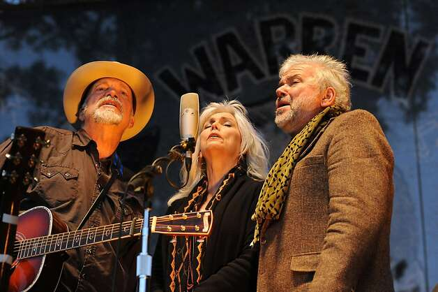 (L-R)Phil Maderia, Emmylou Harris, and Rickie Simpkins sing together during the last set of the festival on the Banjo Stage.  Day 3 of the Hardly Strictly Bluegrass festival in Golden Gate Park in San Francisco, CA Sunday October 7th, 2012. Photo: Michael Short, Special To The Chronicle