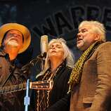 (L-R)Phil Maderia, Emmylou Harris, and Rickie Simpkins sing together during the last set of the festival on the Banjo Stage.  Day 3 of the Hardly Strictly Bluegrass festival in Golden Gate Park in San Francisco, CA Sunday October 7th, 2012.