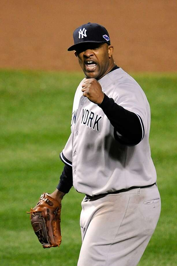 BALTIMORE, MD - OCTOBER 07:  CC Sabathia #52 of the New York Yankees reacts after Mark Reynolds #12 of the Baltimore Orioles grounded out for the final out in the bottom of the eighth inning during Game One of the American League Division Series at Oriole Park at Camden Yards on October 7, 2012 in Baltimore, Maryland.  (Photo by Patrick McDermott/Getty Images) Photo: Patrick McDermott, Getty Images