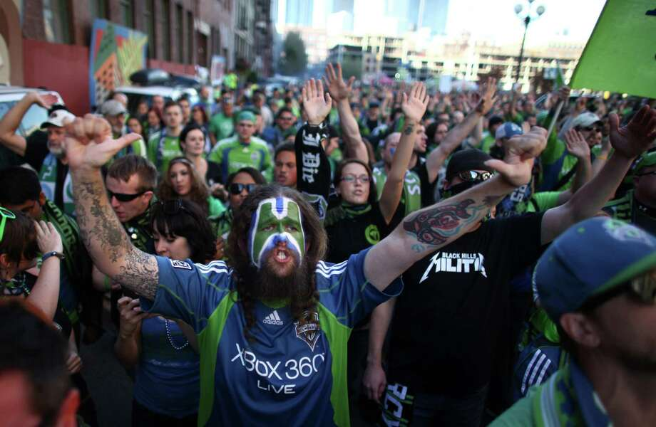 Members of the Emerald City Supporters march to the match between the Seattle Sounders and Portland Timbers on Sunday, October 7, 2012 at CenturyLink Field in Seattle. The Sounders beat the Timbers in front of a Seattle record MLS crowd of more than 66,000 fans. The sounders won 3-0. Photo: JOSHUA TRUJILLO / SEATTLEPI.COM
