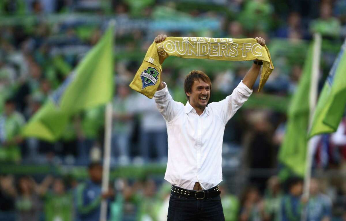 Former Seattle Sounders player Roger Levesque hoists the Golden Scarf before a game against the rival Portland Timbers on Sunday, October 7, 2012 at CenturyLink Field in Seattle. The Sounders beat the Timbers in front of a Seattle record MLS crowd of more than 66,000 fans. The sounders won 3-0.