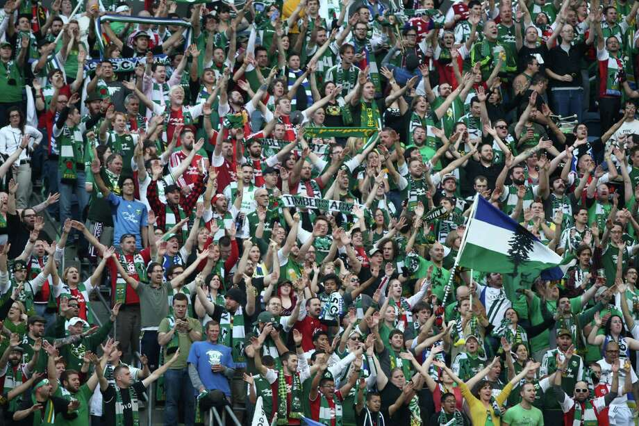 The Portland Timbers Army cheers on their team during a game against the Seattle Sounders on Sunday, October 7, 2012 at CenturyLink Field in Seattle. The Sounders beat the Timbers in front of a Seattle record MLS crowd of more than 66,000 fans. The sounders won 3-0. Photo: JOSHUA TRUJILLO / SEATTLEPI.COM