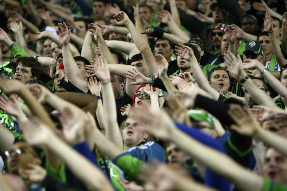 Fans cheer for the Seattle Sounders during a game against rival Portland Timers on Sunday, October 7, 2012 at CenturyLink Field in Seattle. The Sounders beat the Timbers in front of a Seattle record MLS crowd of more than 66,000 fans. The sounders won 3-0. Photo: JOSHUA TRUJILLO / SEATTLEPI.COM