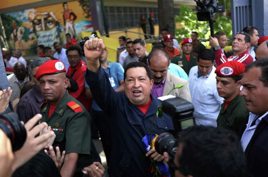 Venezuela's President Hugo Chavez arrives to a polling station during the presidential election in Caracas, Venezuela, Sunday, Oct. 7, 2012.  Chavez is running for re-election against opposition candidate Henrique Capriles.  (AP Photo/Rodrigo Abd) Photo: Rodrigo Abd