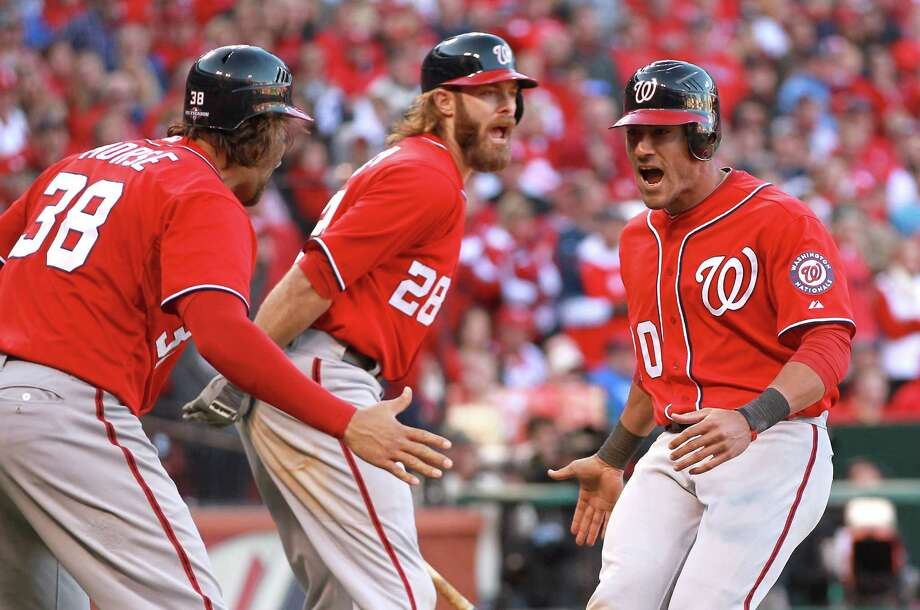 Michael Morse (38), Jayson Werth (28) and Ian Desmond celebrate after Morse and Desmond scored the tying and go-ahead runs in the eighth inning. Photo: Dilip Vishwanat / 2012 Getty Images