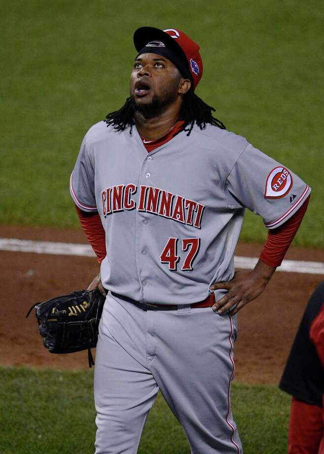 Johnny Cueto's frustration shows as he departs after throwing only eight pitches Saturday night. Photo: Jose Carlos Fajardo / Contra Costa Times