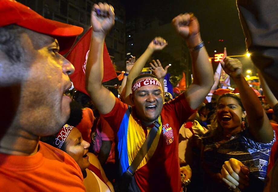 Supporters of Venezuelan President Hugo Chavez celebrate in Caracas after receiving news of his re-election with 54.4 percent of the vote. Photo: Luis Acosta, AFP/Getty Images