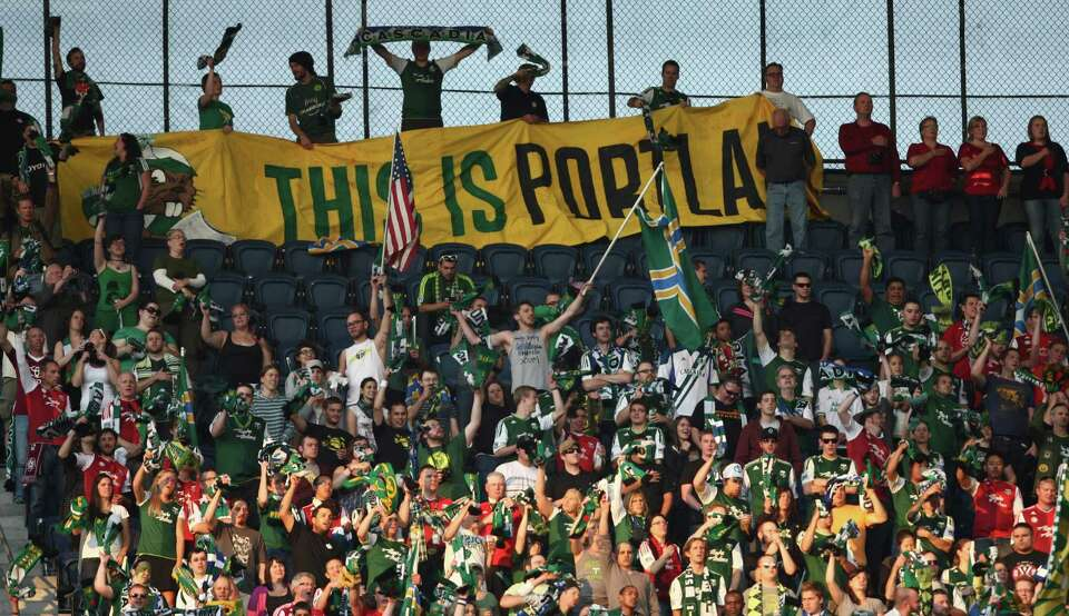 Portland Timbers fans cheer for the team during a game between the Pacific Northwest rivals on Sunda