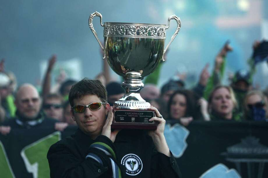 Seattle Sounders fans carry the Cascadia Cup before a match against the Portland Timbers on Sunday, October 7, 2012 at CenturyLink Field in Seattle. The Sounders beat the Timbers in front of a Seattle record MLS crowd of more than 66,000 fans. The sounders won 3-0. Photo: JOSHUA TRUJILLO / SEATTLEPI.COM