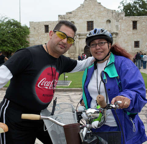 From the left, Jerry and Annie Moreno participating in Síclovía, from Alamo Plaza to Mahncke Park, Sunday, October 7, 2012. Photo: J. MICHAEL SHORT, For The Express-News / The San Antonio Express-News