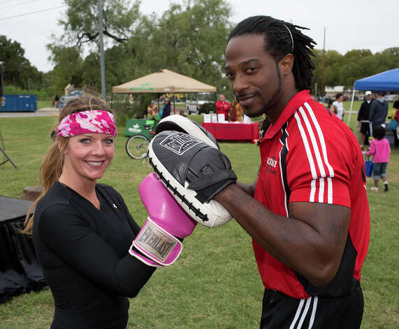 From the left, Karla André and Jermaine Collier with Ripley and Indie, participating in Síclovía, from Alamo Plaza to Mahncke Park, Sunday, October 7, 2012. Photo: J. MICHAEL SHORT, For The Express-News / The San Antonio Express-News