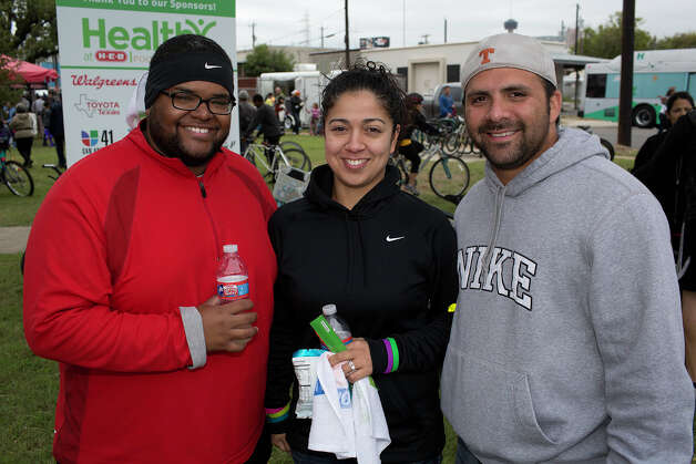 From the left, Joshua Glenn, Jessica Ramon and Ismael Rocha with Ripley and Indie, participating in Síclovía, from Alamo Plaza to Mahncke Park, Sunday, October 7, 2012. Photo: J. MICHAEL SHORT, For The Express-News / The San Antonio Express-News