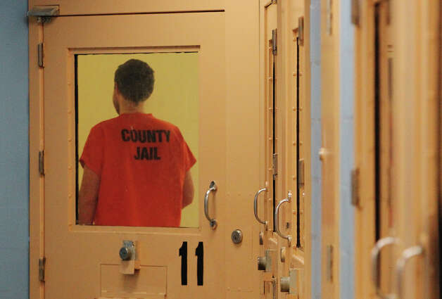 An inmate in the mental health unit strolls in his cell at the Bexar County Jail on Thursday, Oct. 4, 2012. Photo: Kin Man Hui, SAN ANTONIO EXPRESS-NEWS / ©2012 San Antonio Express-News