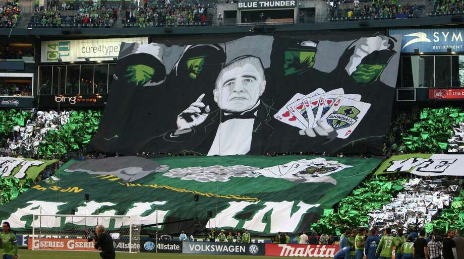 A Tifo created by Seattle Sounders fans is unfurled before a match against the Portland Timbers on Sunday, October 7, 2012 at CenturyLink Field in Seattle. The Sounders beat the Timbers in front of a Seattle record MLS crowd of more than 66,000 fans. The sounders won 3-0. Photo: JOSHUA TRUJILLO / SEATTLEPI.COM