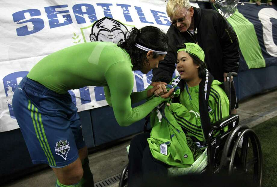 "Seattle Sounders player Fredy Montero gives his game jersey to Patthama ""Mew"" Sabprasert, 15, who recently spent 10 months in Seattle Childrens Hospital for an autoimmune disorder after the sounders beat the Portland Timbers on Sunday, October 7, 2012 at CenturyLink Field in Seattle. The Sounders beat the Timbers in front of a Seattle record MLS crowd of more than 66,000 fans. The sounders won 3-0. Photo: JOSHUA TRUJILLO / SEATTLEPI.COM"