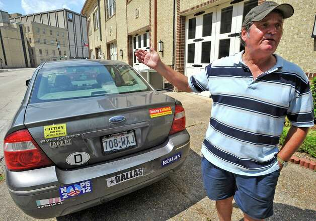 John W. Smith Jr., 63, a retired news director, drives a Ford Five Hundred with over 40,000 miles on it that also now reflects his political views.  While he was working, he had to keep his views to himself and off his car.  Dave Ryan/The Enterprise