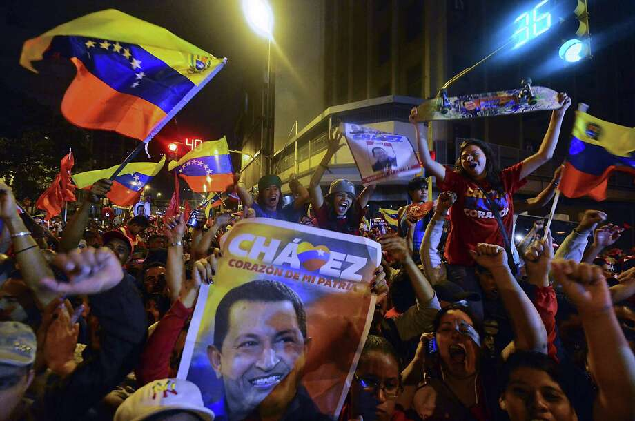 TOPSHOTS  Supporters of Venezuelan President Hugo Chavez celebrate after receiving news of his reelection in Caracas on October 7, 2012. According to the National Electoral Council, Chavez was reelected with 54.42% of the votes, beating opposition candidate Henrique Capriles, who obtained 44.97%. AFP PHOTO/Luis AcostaLUIS ACOSTA/AFP/GettyImages Photo: LUIS ACOSTA, AFP/Getty Images / AFP