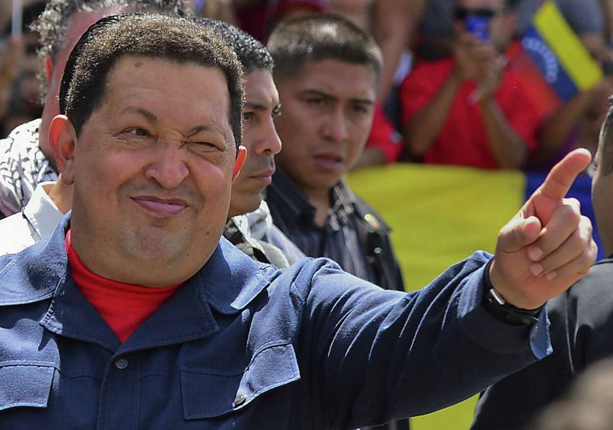 TOPSHOTS Venezuelan President Hugo Chavez gestures at supporters before casting his vote in Caracas on election day, on October 7, 2012. Venezuelans voted Sunday with President Hugo Chavez's 14-year socialist revolution on the line as the leftist leader faced youthful rival Henrique Capriles in his toughest electoral challenge yet. AFP PHOTO/LUIS ACOSTALUIS ACOSTA/AFP/GettyImages