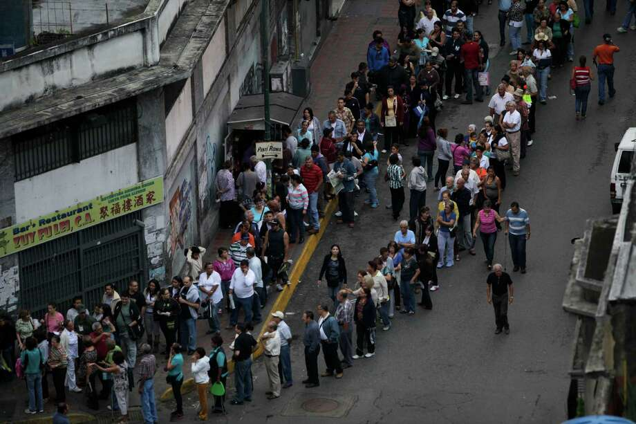 People line up to vote in the presidential election in Caracas, Venezuela, Sunday, Oct. 7, 2012.  President Hugo Chavez is running against opposition candidate Henrique Capriles. Photo: Enric Marti, AP / AP