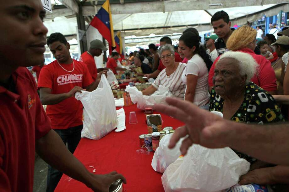 Residents buy subsidized food at a government market in Caracas, Venezuela, Saturday, Oct. 6, 2012. President Hugo Chavez is running for re-election against opposition candidate Henrique Capriles in Sunday's presidential election. Photo: Rodrigo Abd, AP / AP