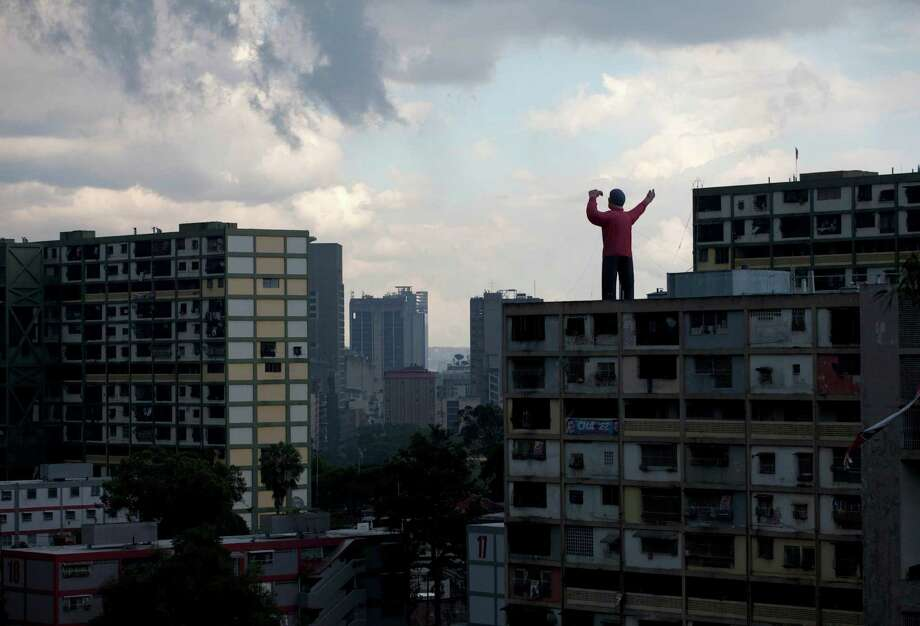 A giant inflatable doll representing President Hugo Chavez stands on top of a building in Caracas, Venezuela, Saturday, Oct. 6, 2012. Chavez is running for re-election against opposition leader Henrique Capriles in Sunday's presidential election. Photo: Ramon Espinosa, AP / AP