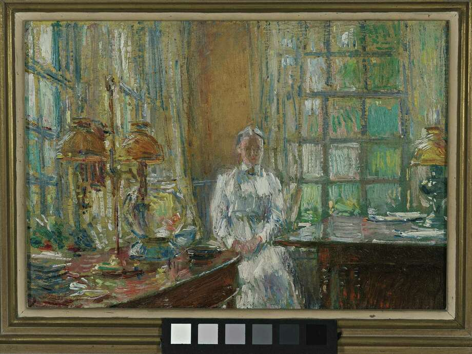 """Mrs. Holley of Cos Cob,"" a 1912 painting by Childe Hassam, is on view in ""A Good Light: The Artist's Studio in Cos Cob and Beyond""  at the Greenwich Historical Society Bush-Holley Historic Site. The exhibition explores the changing concept of the artist's studio. Photo: Contributed Photo"