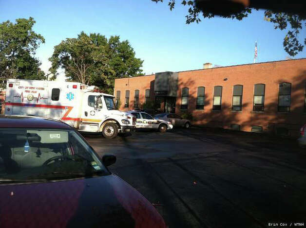 An ambulance on the scene of a fatal shooting at Electrix on Spring St. in New Haven, Oct. 8, 2012. Photo: Contributed