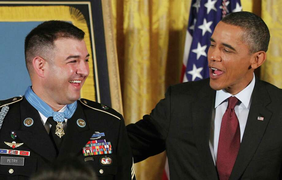 President Barack Obama congratulates U.S. Army Sgt. 1st Class Leroy Arthur Petry    after  presenting him the Medal of Honor during a 2011 ceremony.