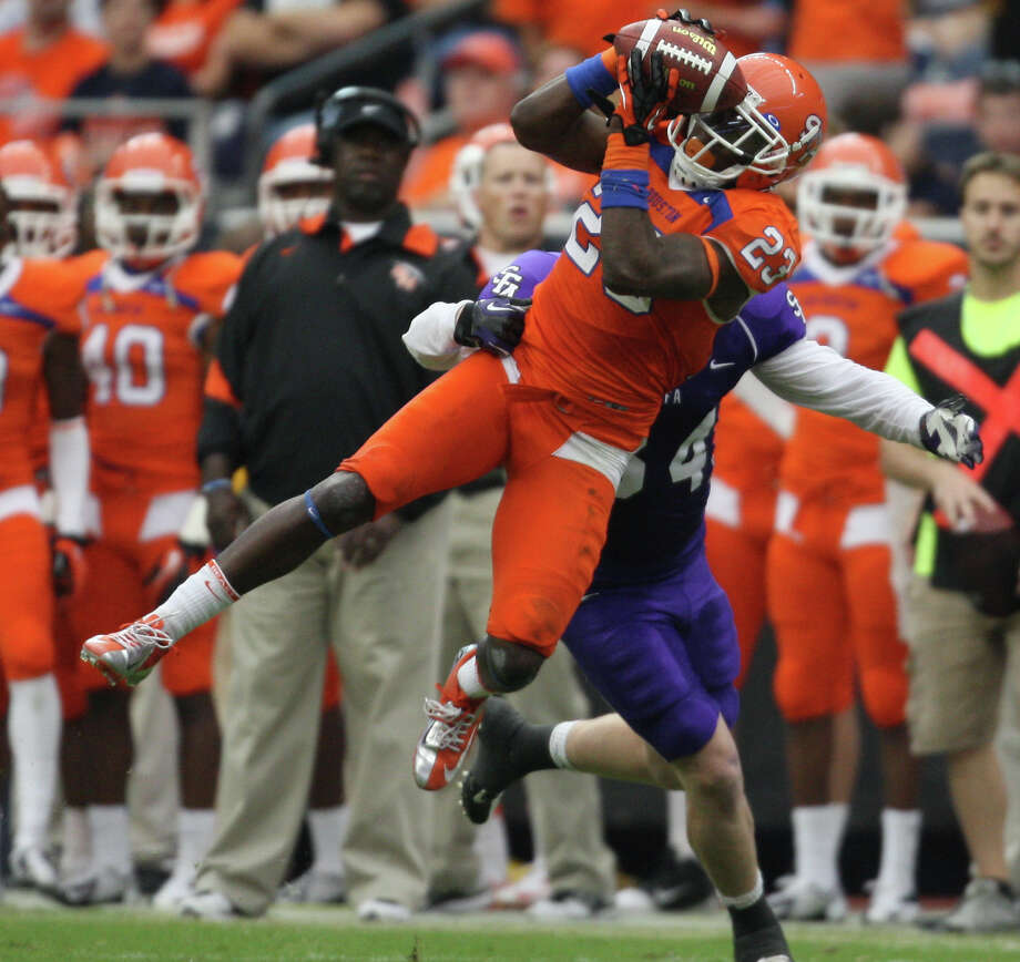 Sam Houston State's Robert Shaw breaks up a pass intended for SFA's Ryan Gambel during the first half. Photo: Eric Christian Smith, For The Chronicle