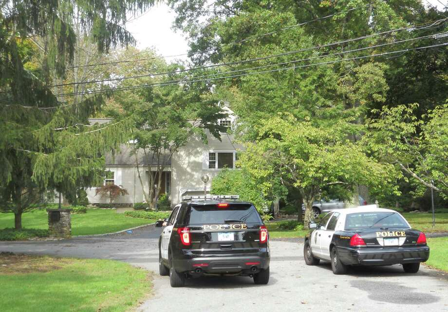 Police cruisers were parked outside 10 Rustic Lane at approximately 11 a.m., as police investigated a death in Westport that may be linked to a fatal shooting Monday morning in New Haven. Monday, Oct. 8, 2012/ Westport, CT Photo: Paul Schott / Westport News
