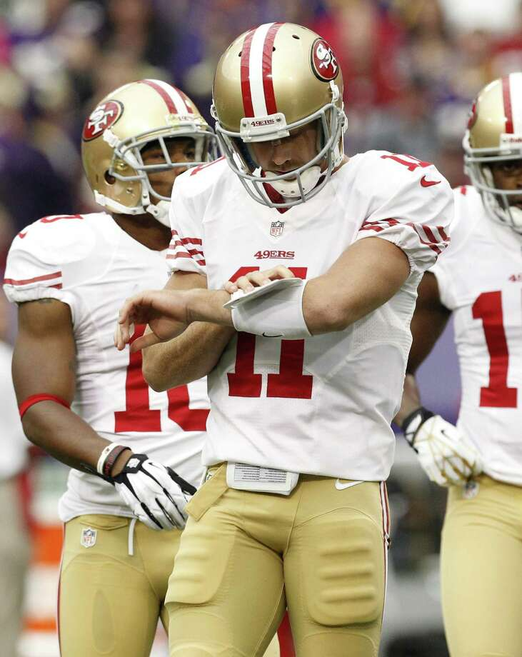 San Francisco 49ers quarterback Alex Smith (11) calls a play in the huddle during the first half of an NFL football game against the Minnesota Vikings Sunday, Sept. 23, 2012, in Minneapolis. Photo: Genevieve Ross, Associated Press / FR170496 AP